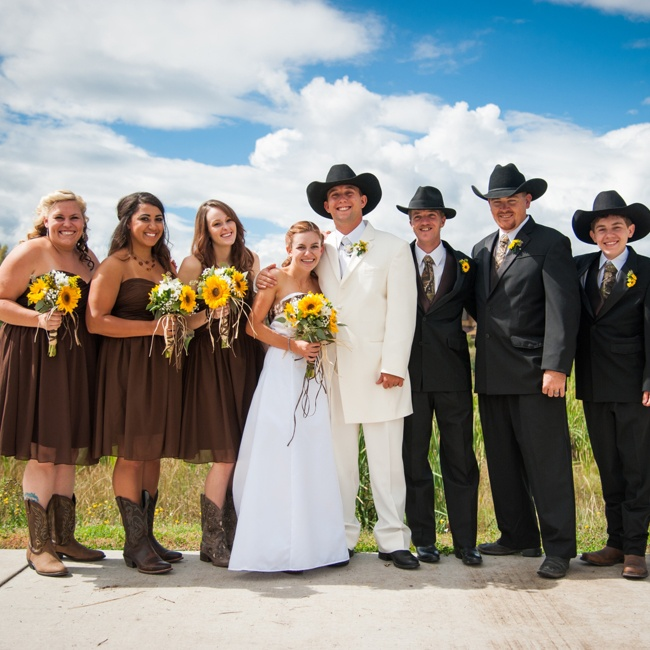 The dark bridesmaid dresses and cowboy boots coordinated with the groomsmen's camo ties and cowboy hats.