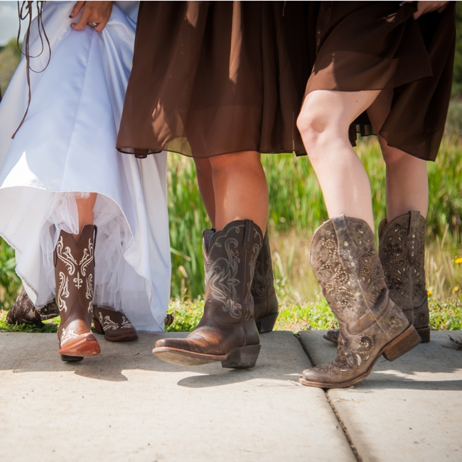 Tayler's bridesmaids wore short dresses that displayed their bold cowboy boots and even the bride was matching under her gown.