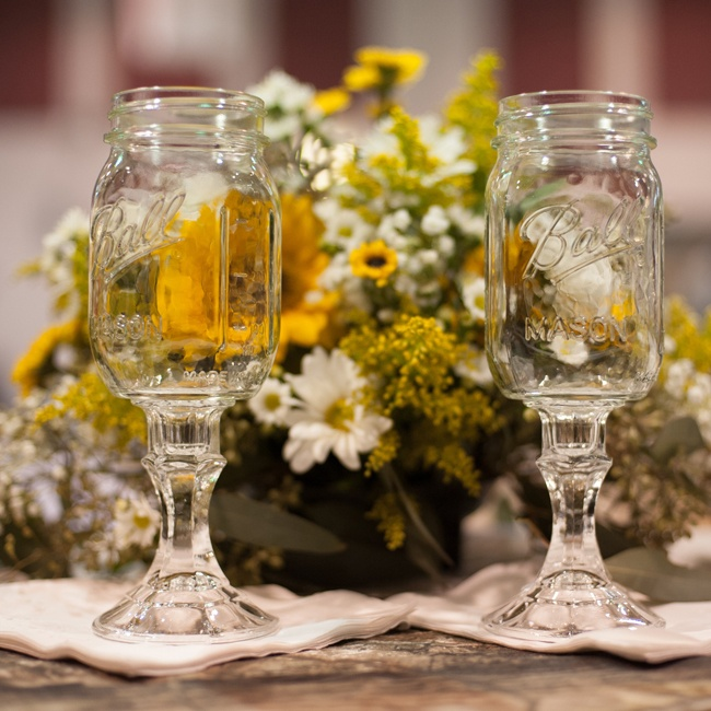 The couple toasted with mason jar pedestal glasses, also know as redneck wine glasses.