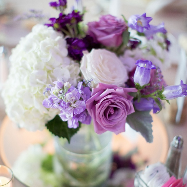 Tables were decorated with shabby chic purple centerpieces