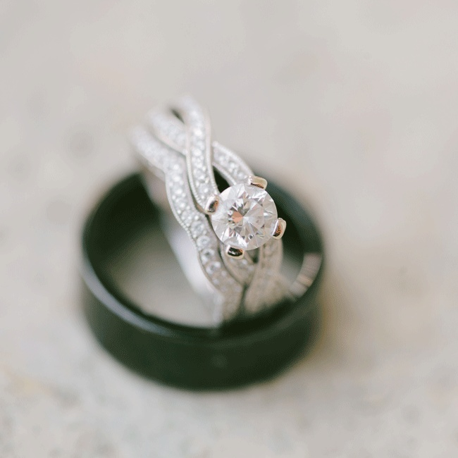 The couple exchanged original bands, a tungsten carbide ring for the groom and a curved band to fit the bride's criss-cross engagement ring.
