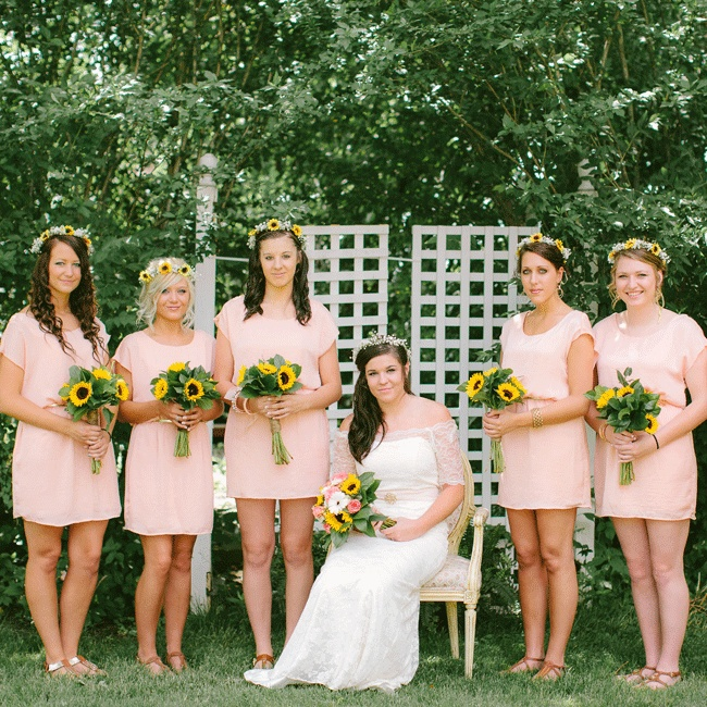 Ashley fell in love with the simplicity of her bridesmaid dresses and completed the summer look with fresh sunflower headpieces and matching bouquets.