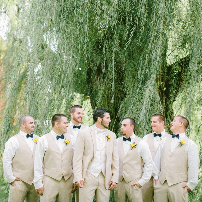 Jordan stood apart from his groomsmen in a tan Lord West Havana suit and light bow tie while his guys wore vests, navy bow ties and brown shoes of their choice.