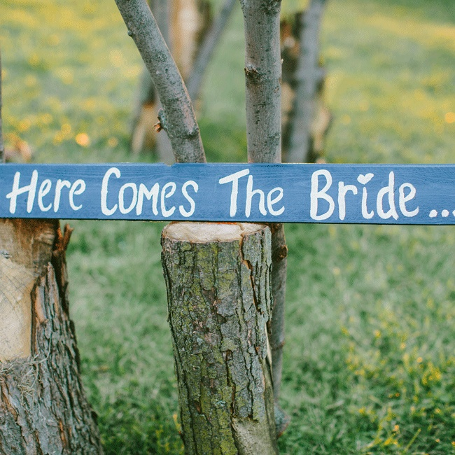 The ring bearers carried this adorable sign down the aisle announcing the bride.