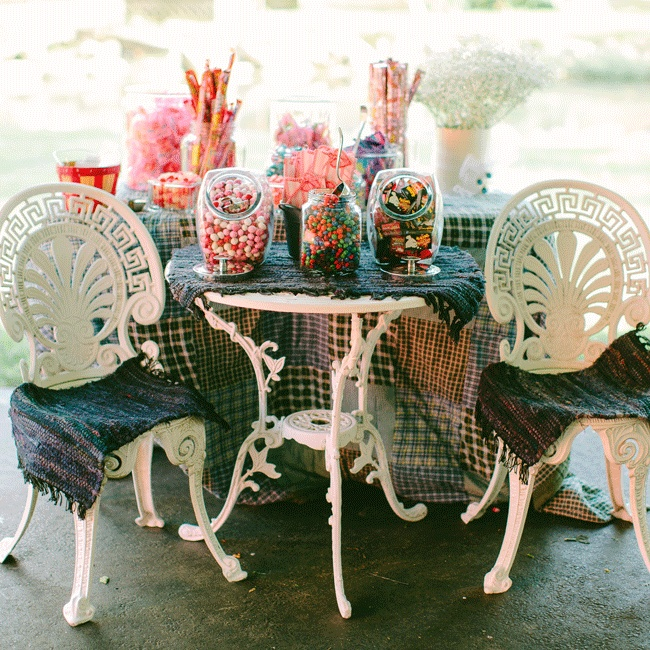 Ashley and Jordan treated guests to a fully stocked candy bar charmingly displayed on an antique table with vintage tablecloth.