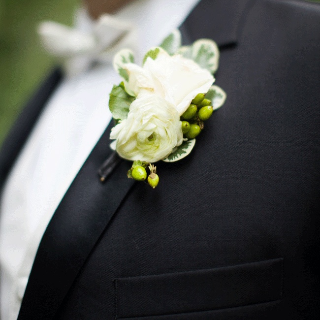 The groomsmen wore a simple white ranunculus accented with a few green berries.