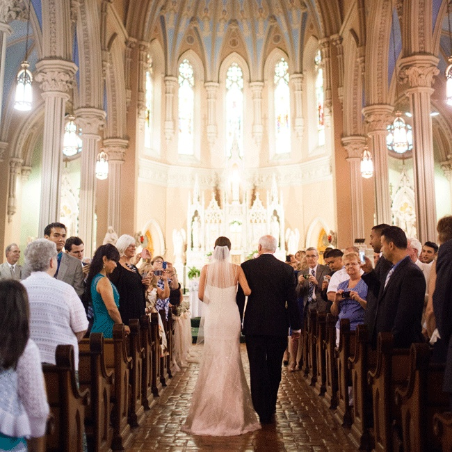 The couple were married in a classic cathedral style church surrounded by a beautiful white marble alter, emerald green flooring and dark wooden pews.