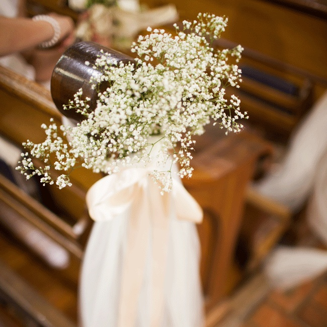 Tulle, baby's breathe and a simple ivory bow adorned the aisle pews.