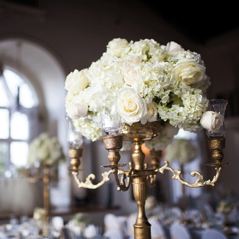 Lauren selected five-feet-tall gold brass candelabras which spoke to The Plaza Hotel's elegant vibe.