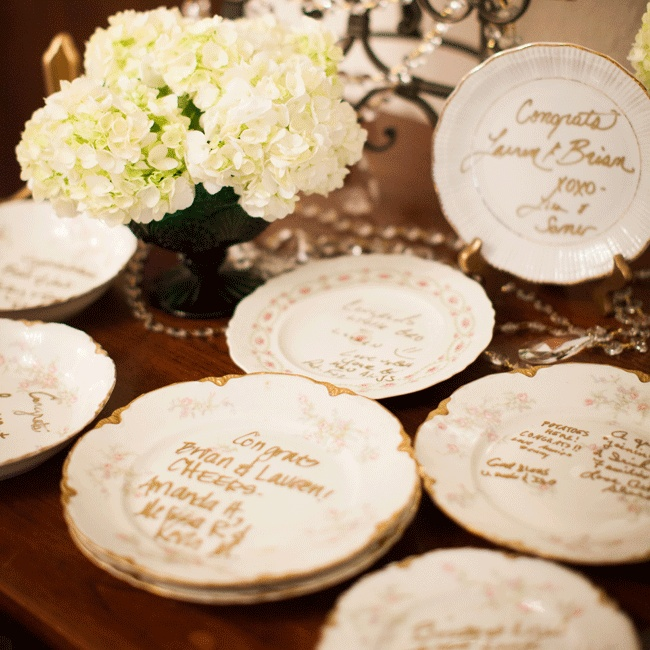 The couple provided a collection of antique plates for guests to write messages on in gold.