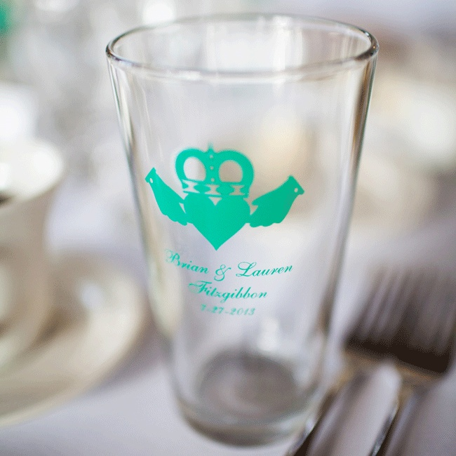 A pint glass etched in green with a claddagh sign and the couple's name was set at each seat for guests to use throughout the night.