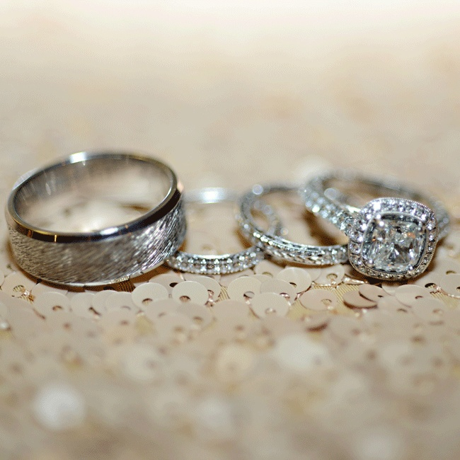 The bride paired her vintage cushion cut diamond halo engagement ring with two thin bands.
