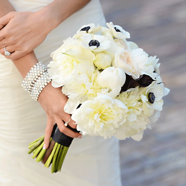 The large 14 inch bouquet elegantly incorporated white peonies, blush cafe au lair dahlias, black and white anemones, white calla lilies and black schwartzwalder calla lilies for additional dimension.