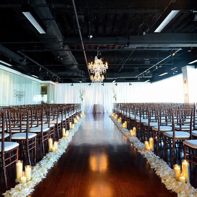 The 'U' shaped room with an open concept black ceiling was curtained off in one area to create a rectangular ceremony space that was also used for the cocktail hour.