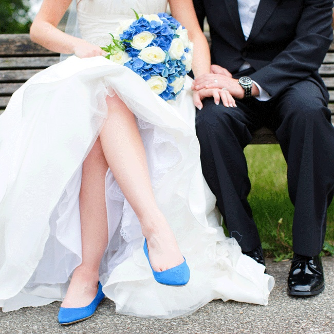The bride looked for comfort when selecting her bold flats from Express that complemented the royal blue color palette.