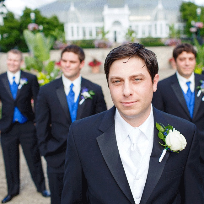 The groom wore a black Calvin Klein tux with a white vest and tie and the groomsmen looked dapper in black Calvin Klein tuxes with royal blue vests and ties.