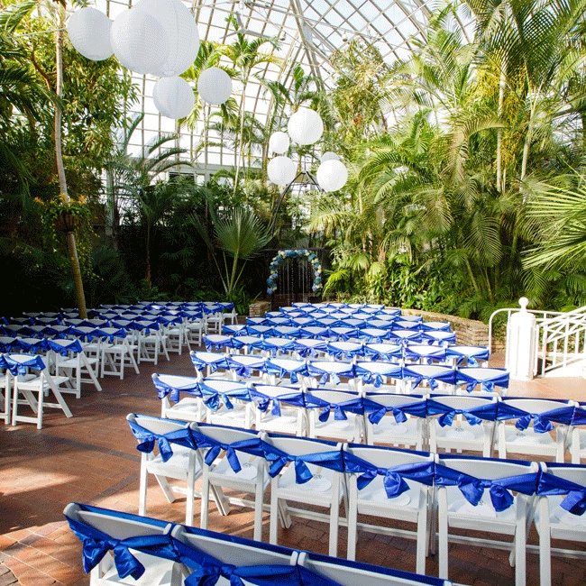 White globe lanterns decorated the ceremony site's ceiling and lit tea lights surrounded the garden fountain.