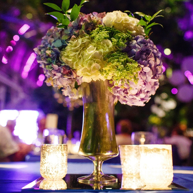 Gold mercury glass vases held stunning white and blue hydrangea arrangements with touches of Queen Anne's lace and Italian ruscus.