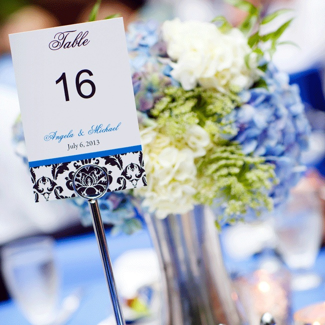 Table numbers were printed on matching black damask stationery and displayed with tall silver stands.