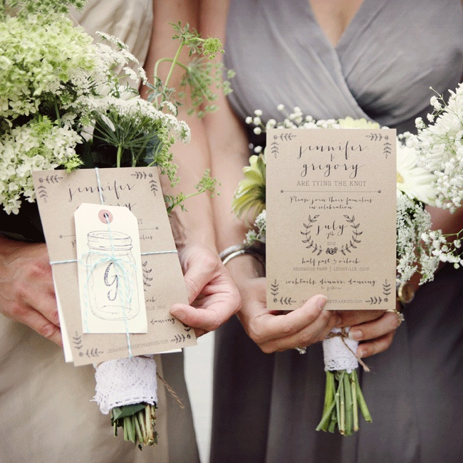 The couple looked for personal, rustic and natural looking paper goods when selecting the raw butcher block stationery wrapped in baker's twine.  The bride and groom's matching tattoo of a G and J intertwined inspired the design for the custom stamps.