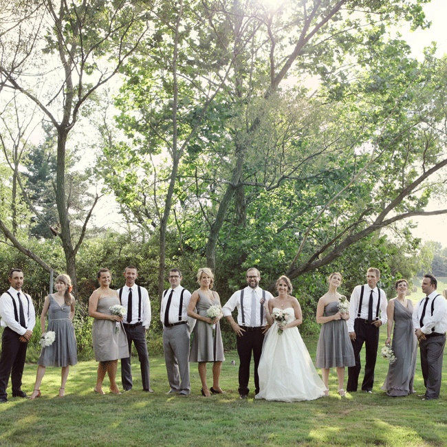 The bridesmaids complemented each other in different J Crew dresses while the groomsmen looked dapper in matching black suspenders and ties along with berry boutonnieres made by the the groom's mother.