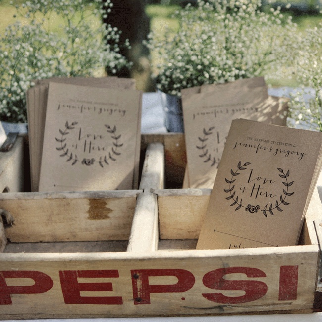 As guests entered the outdoor ceremony space they could take informal raw butcher block programs from a vintage soda crate.