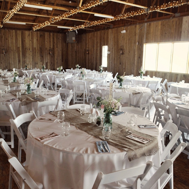 Collectibles and family antiques served as décor for the DIY reception along with burlap table runners and vintage fabric napkins made by the mother of the bride and mason jar centerpieces made by the couple.