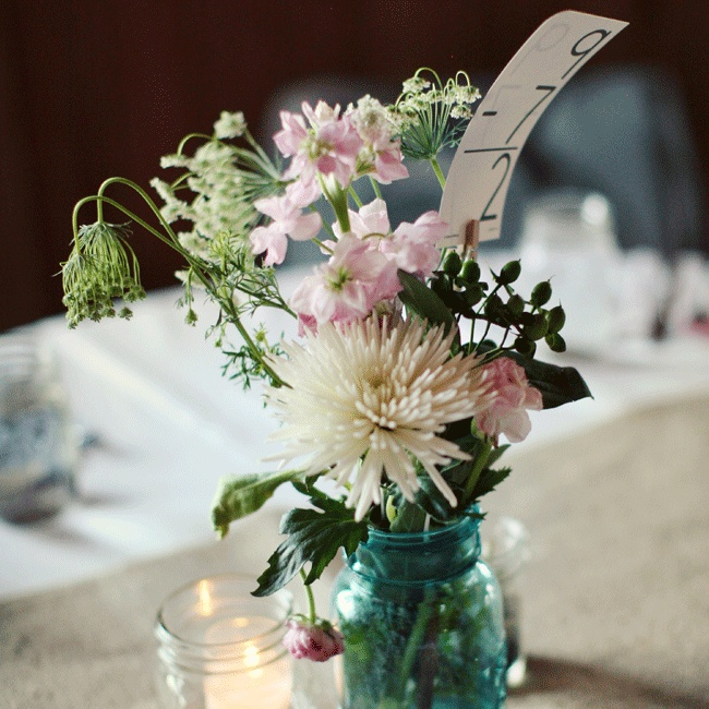 Adorable flash card table numbers gave the vintage blue mason jar DIY centerpieces a personal touch (the bride is a teacher!).