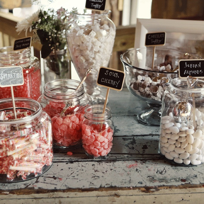 Guests were given Butcher block paper candy bags stamped with the couple's custom tattoo and encouraged to treat help themselves to the candy bar.