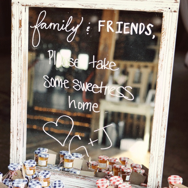 The couple wrote on a gorgeous vintage mirror for guests to enjoy the fruit preserve favors.