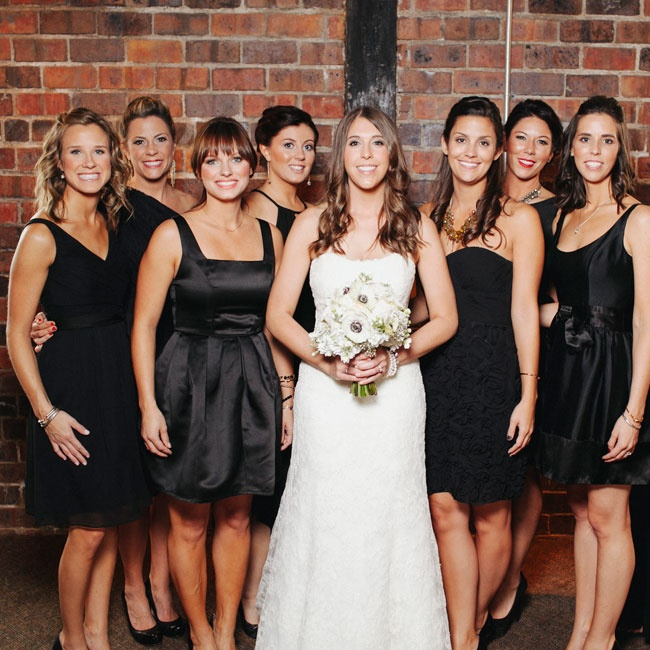 Holly allowed each of her bridesmaid to select a short, black dress of their choice, resulting in a contemporary and polished look.