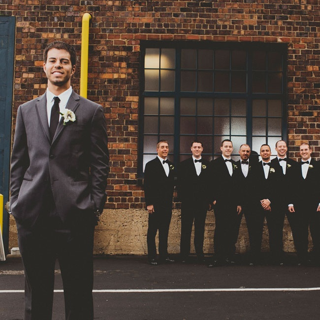 The groom stood out from the sleek groomsmen, wearing Black by Vera Wang, and a solid black necktie.