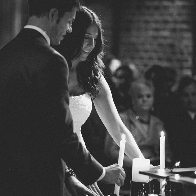 Holly and Brian lit a simple unity candle during their indoor loft reception.