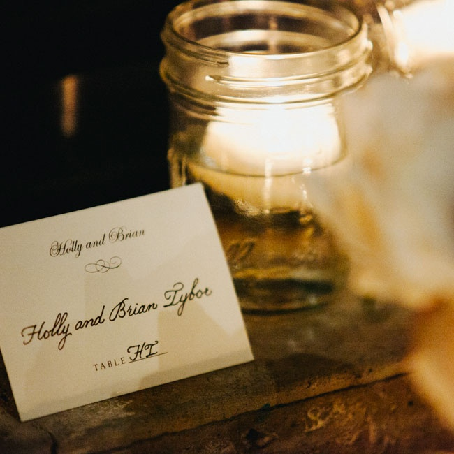 Refined escort cards from Wedding Paper Divas assigned guests their table assignments.