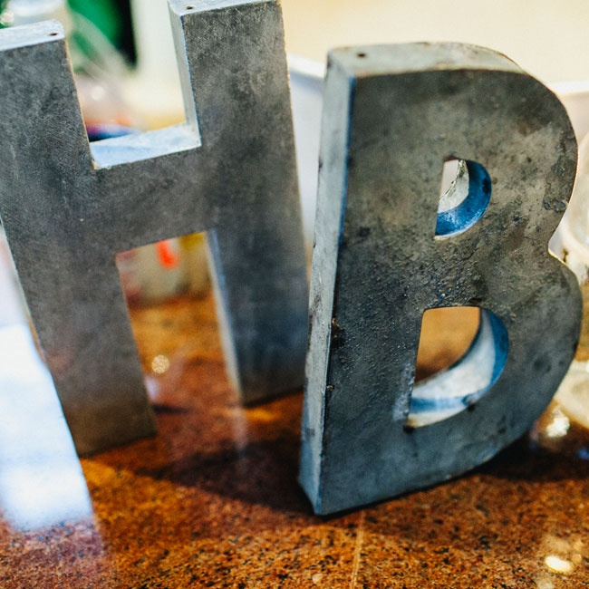 Distressed metallic initials added a personal touch to the loft reception decor.
