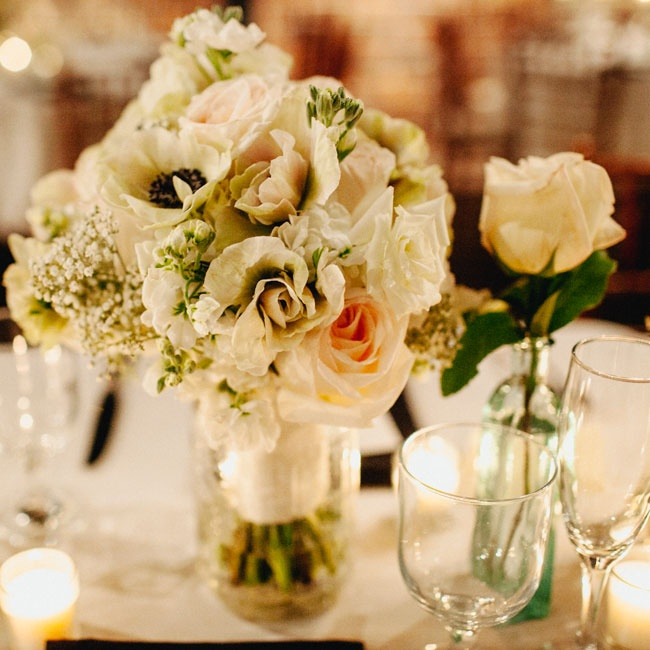 Breathtaking anemones, roses and Queen Anne's Lace warmed the industrial reception site.