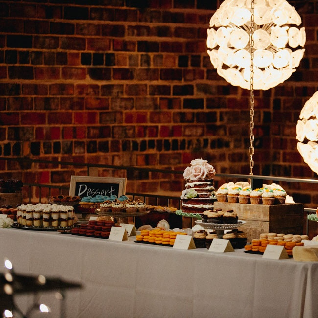 Dessert shooters, homemade cookies and a naked wedding cake were displayed together for a diverse presentation.