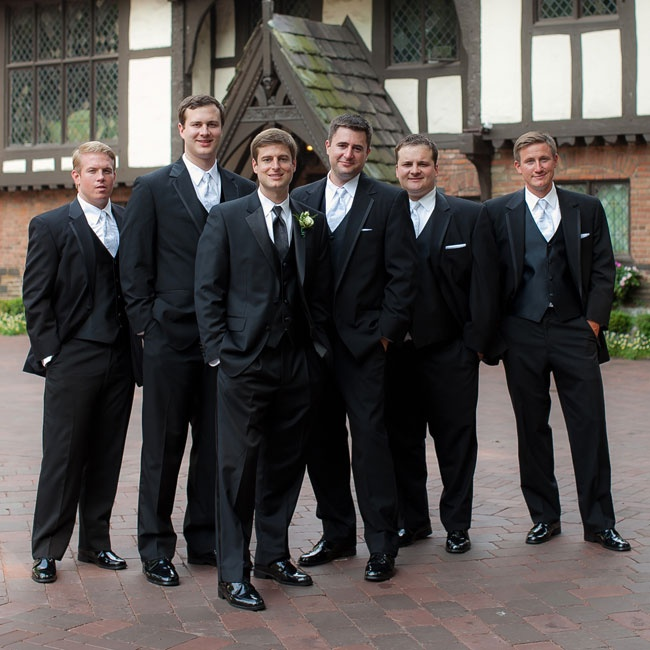 The formal groomsmen looked timeless in classic black suits.