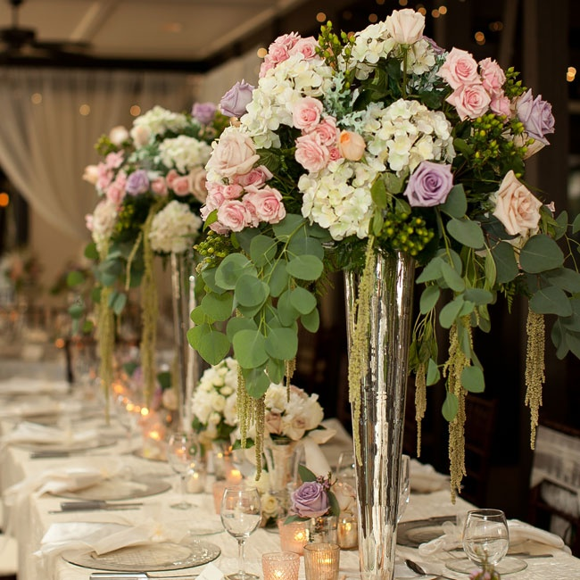 Silver trumpet vases showcased the feminine hydrangea and rose centerpieces.