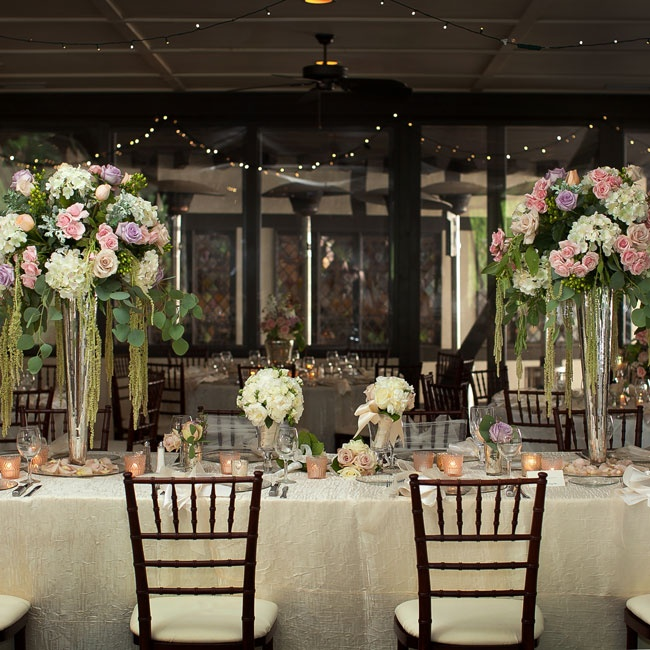 Tall, lush centerpieces decorated Jenna and Adam's ornate indoor reception.