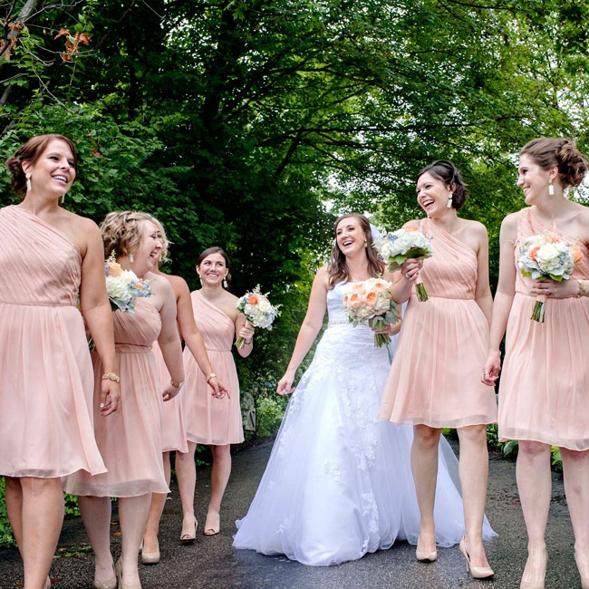 The bridesmaids' soft Ann Taylor one-shoulder dresses and succulent bouquets looked were accessorized with nude pumps and antique gold bracelets.