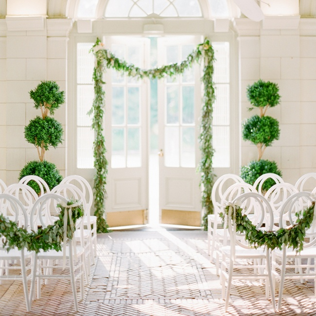 "Start with a simple design and build on it with each event. ""Keep the focus on the couple during the ceremony with crisp, clean decor,"" Julie Savage, founder of Strawberry Milk Events. ""Save the brights for the party."""