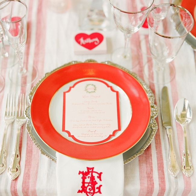 Striped linen runners and loose, overflowing centerpieces keep ornate tableware and monogrammed napkins from feeling stuffy.