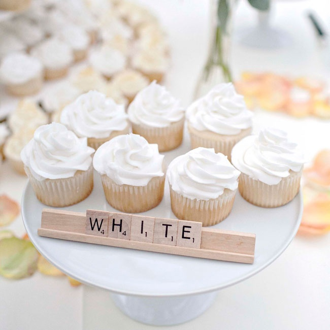 Delicate cupcakes and adorable Scrabble signs created a whimsical dessert table for guests to enjoy.