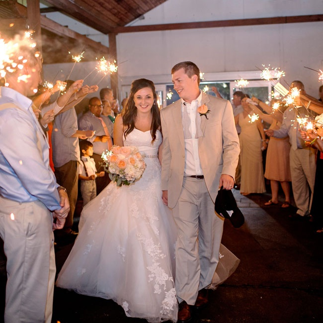 Jenna and Brad left their ceremony surrounded by friends, family and glowing sparklers.