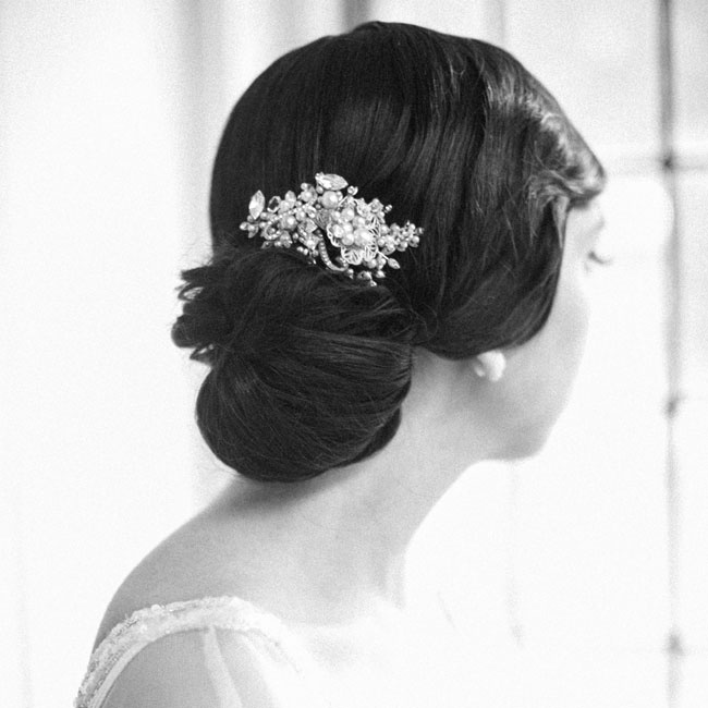 Instead of a veil, Ashely selected crystal and pearl embellished hair comb to complement her simple side updo.