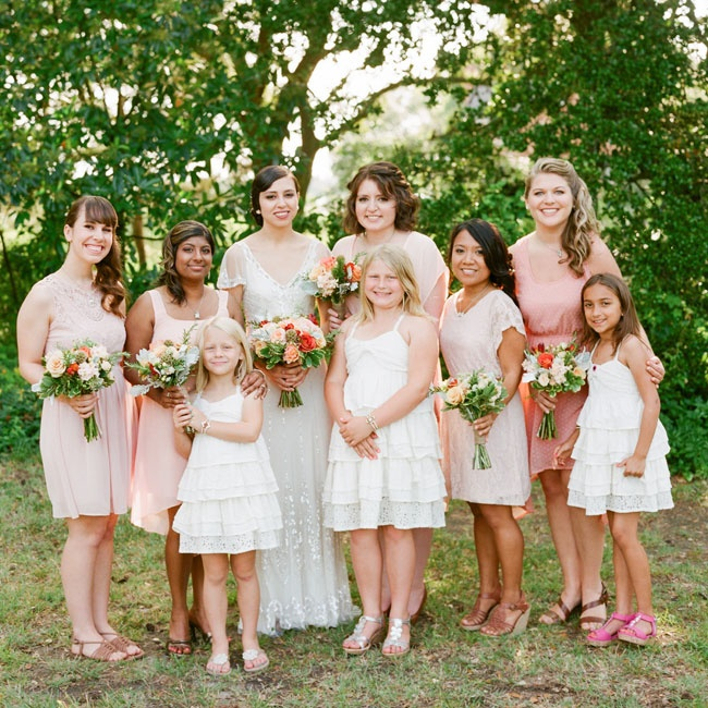 Ashley's bridesmaids wore casual dresses in varying shades of peach and each accessorized with a matching pendant necklace.