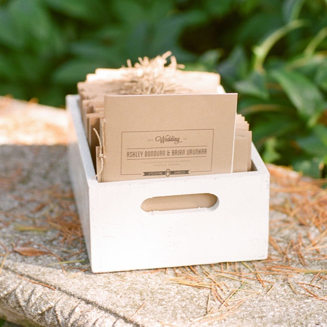 Ashley, a graphic designer, personally designed all of her matching stationery and displayed the organic-inspired programs in a white wooden box.