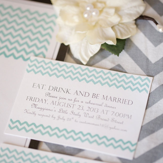 The bride created her modern DIY mint and grey chevron invitations using a chevron template she found online.