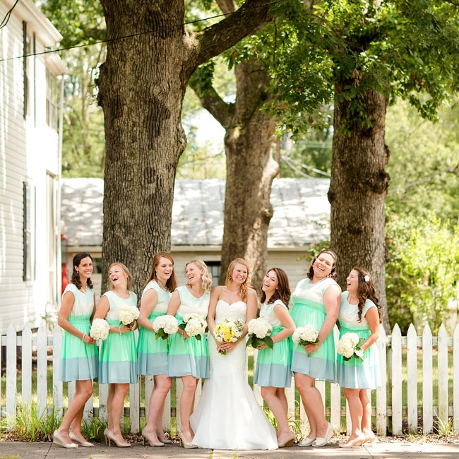 The bridesmaids matched in vibrant colorblock mint dresses from ModCloth with simple white hydrangea bouquets.